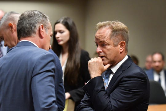 Lead special prosecutor Todd Flood, right, talks with special prosecutor Paul Stablein before the preliminary examination hearing starts at 67th District Court in Flint on Aug. 20, 2018.