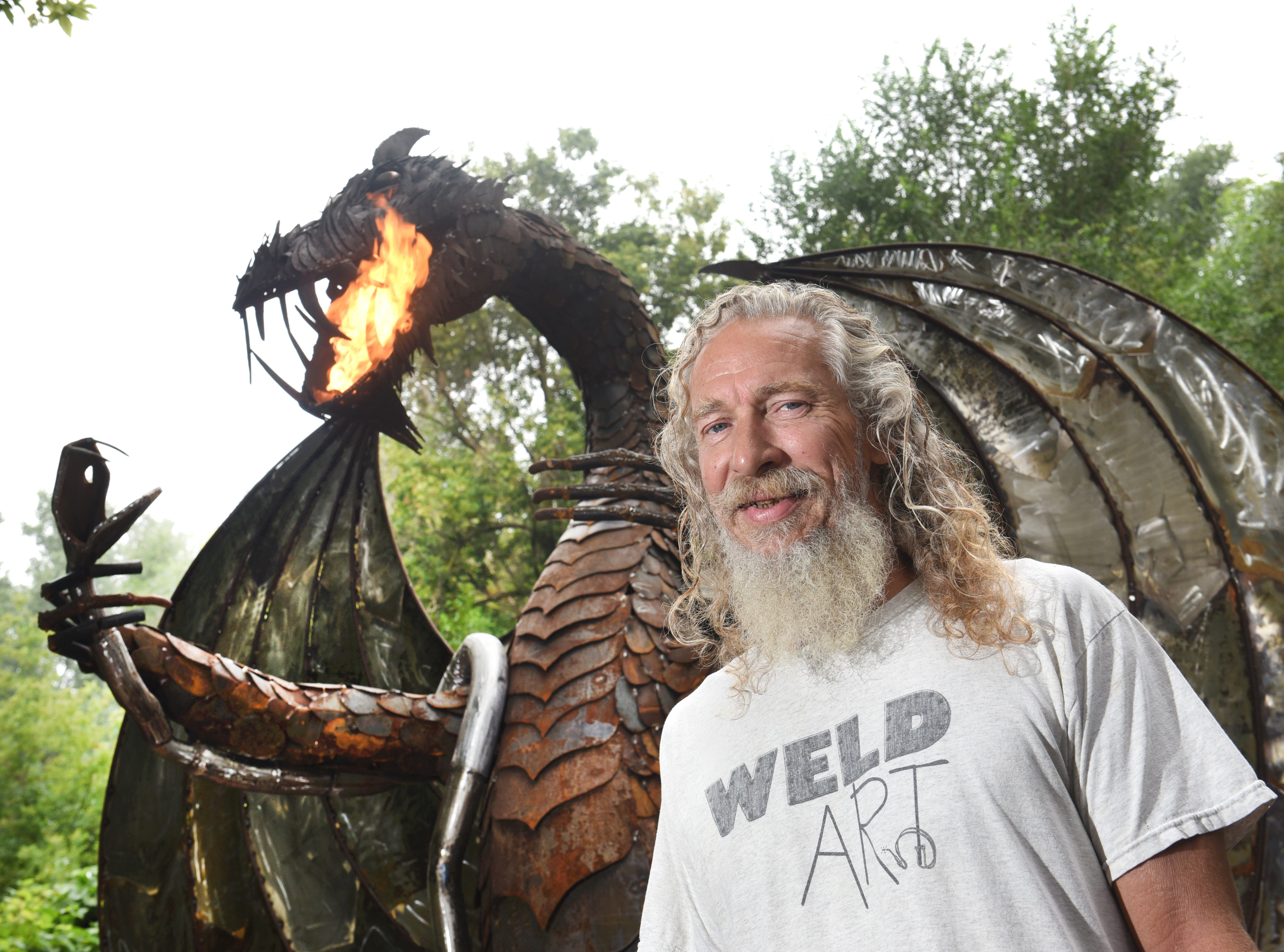 Taylor metalworker Keith Coleman with his 12-foot fire breathing dragon on Thursday, August 16, 2018 will take the metal beast to ArtPrize in September.