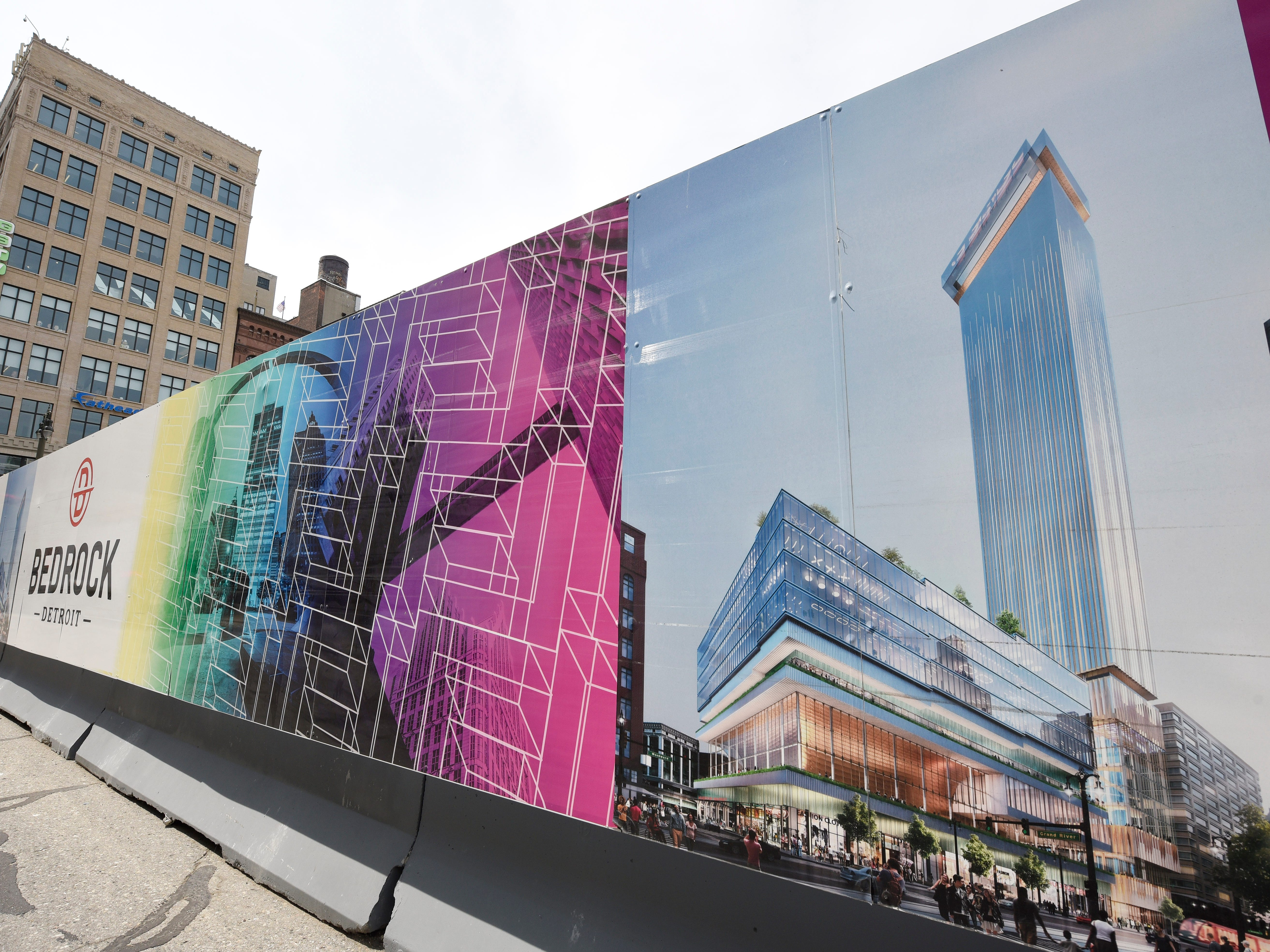 A rendering of the residential tower and mixed use building that will be constructed on the Hudson's site adorns Bedrock's sign at Woodward at Gratiot.