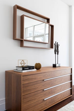 Walnut and other woods are great foundation pieces when looking to achieve a midcentury modern look. (Design Recipes)