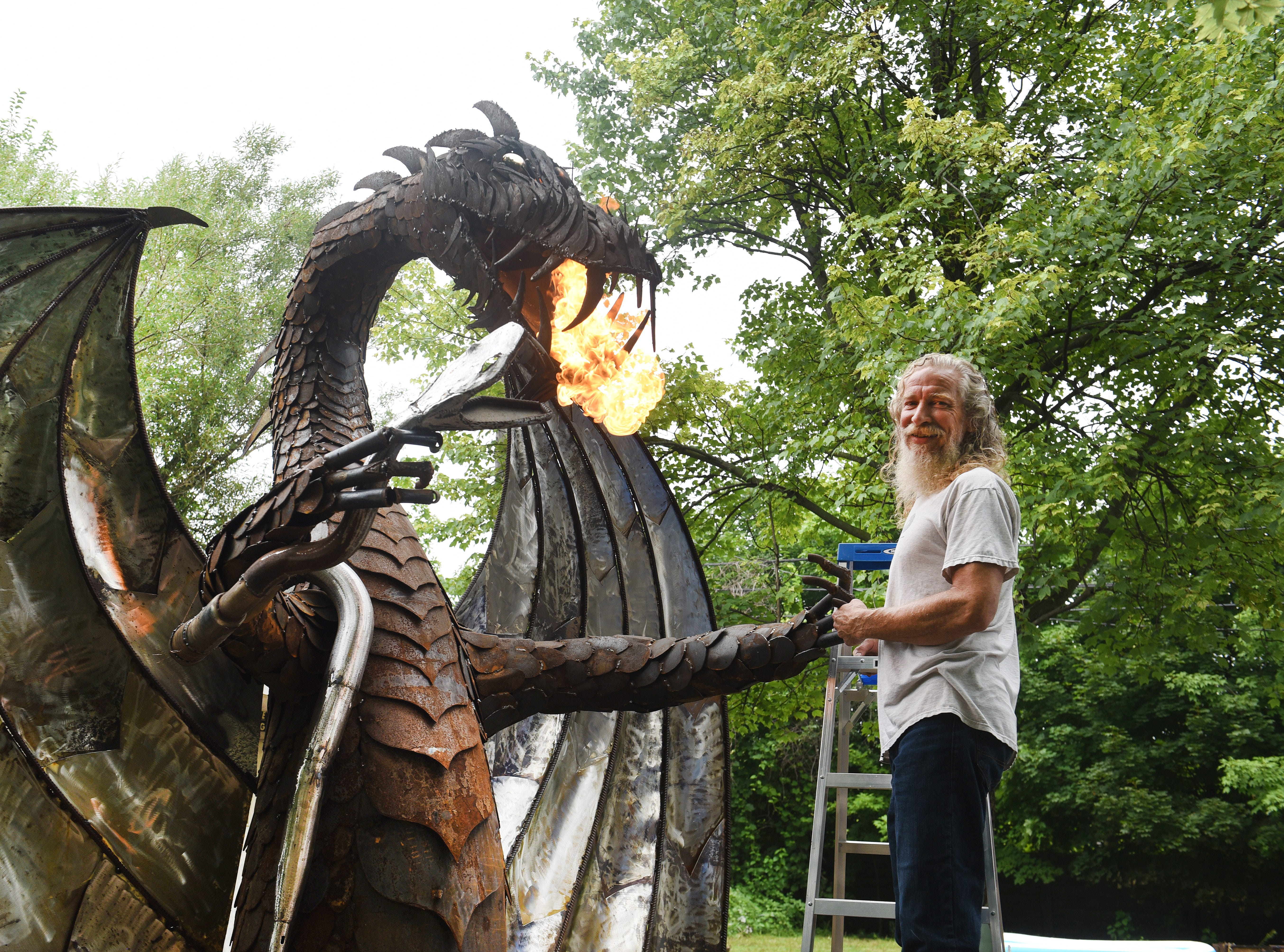 Taylor artist and metalworker Keith Coleman with his 12-foot fire breathing dragon on Thursday, August 16, 2018.