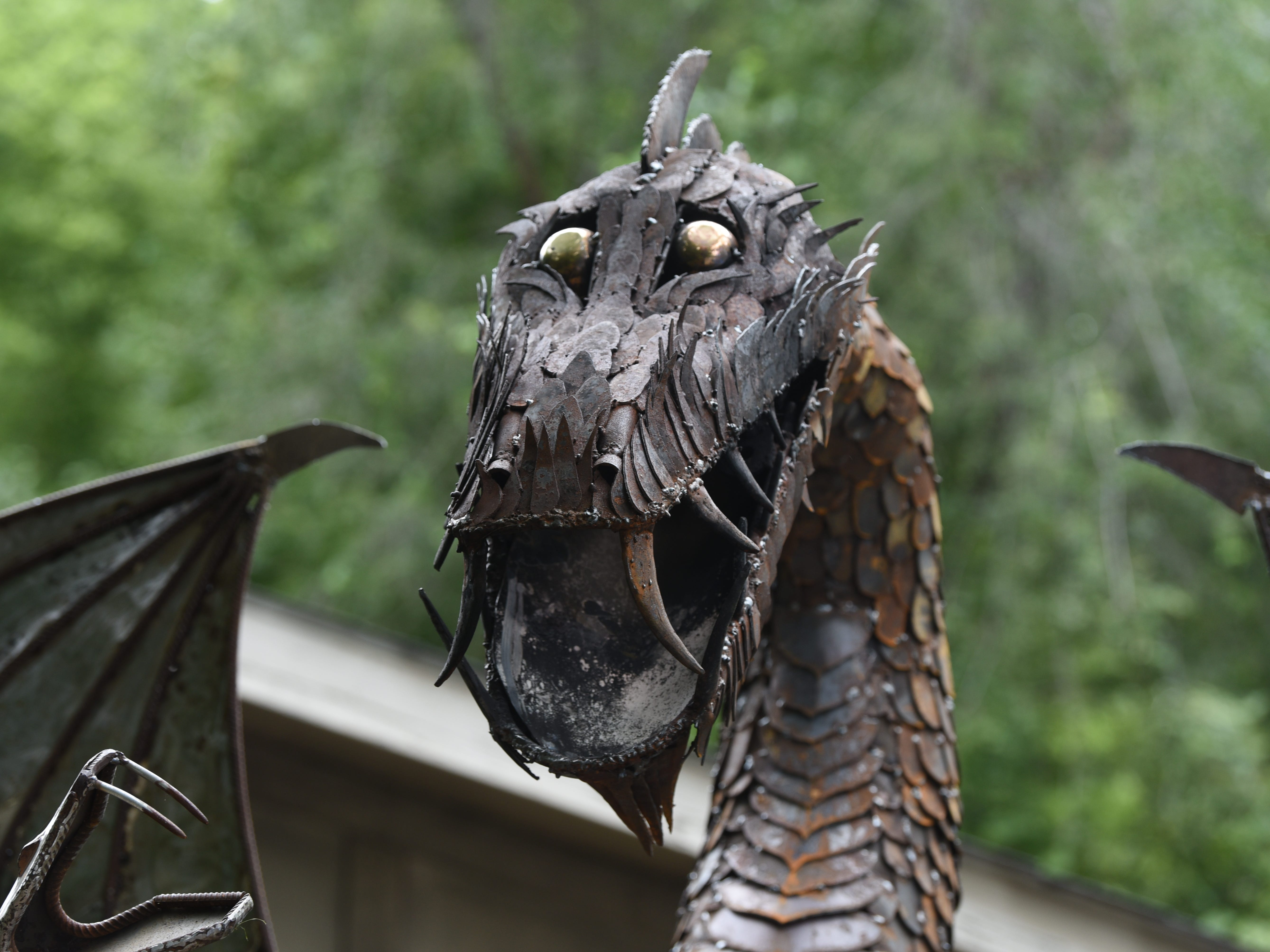 This 12-foot fire breathing dragon has mammoth teeth and shiny eyes as Taylor artist Keith Coleman hopes his creation will win ArtPrize.