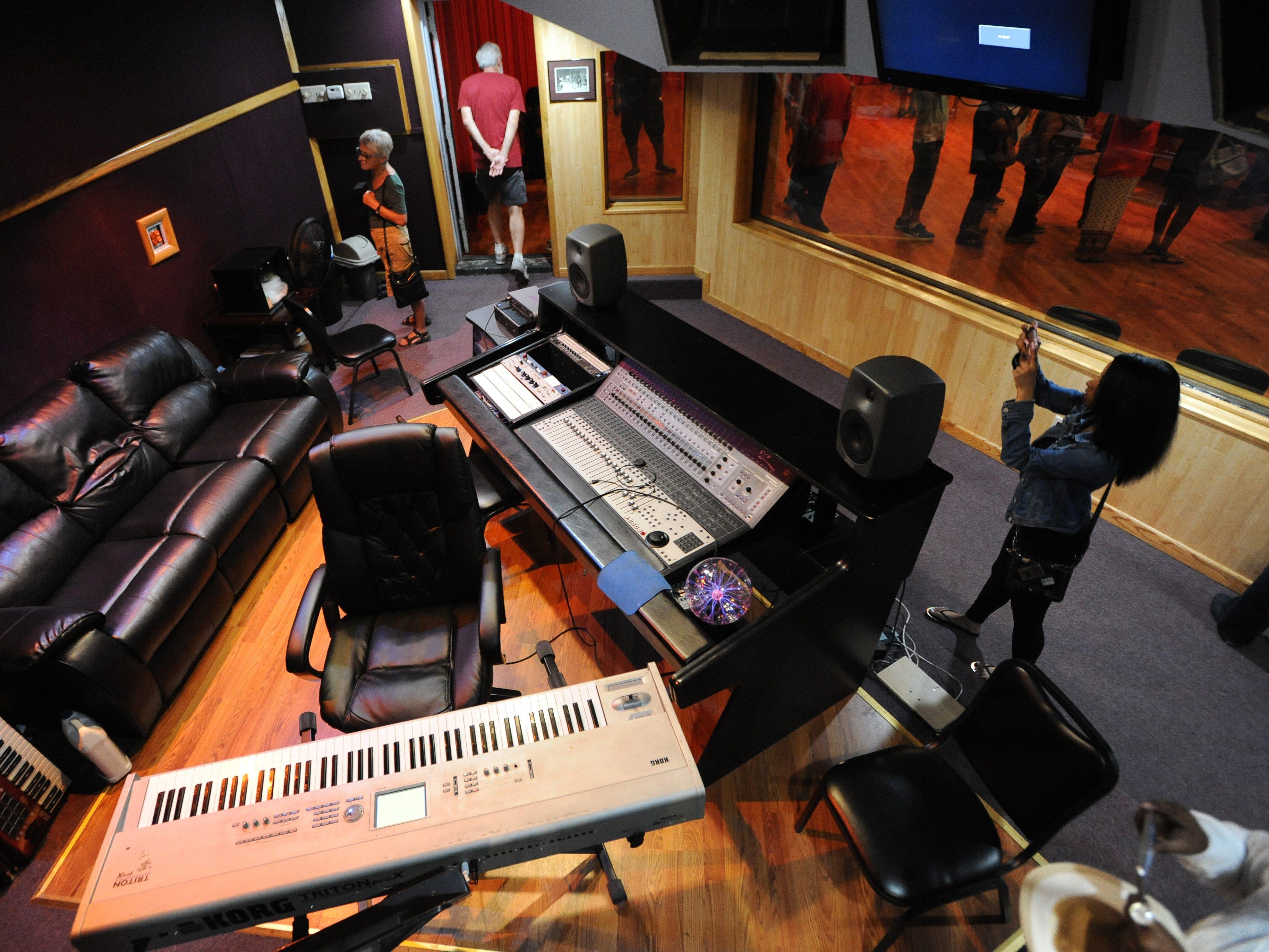 Visitors walk through Studio A at United Sound Systems Recording Studios.