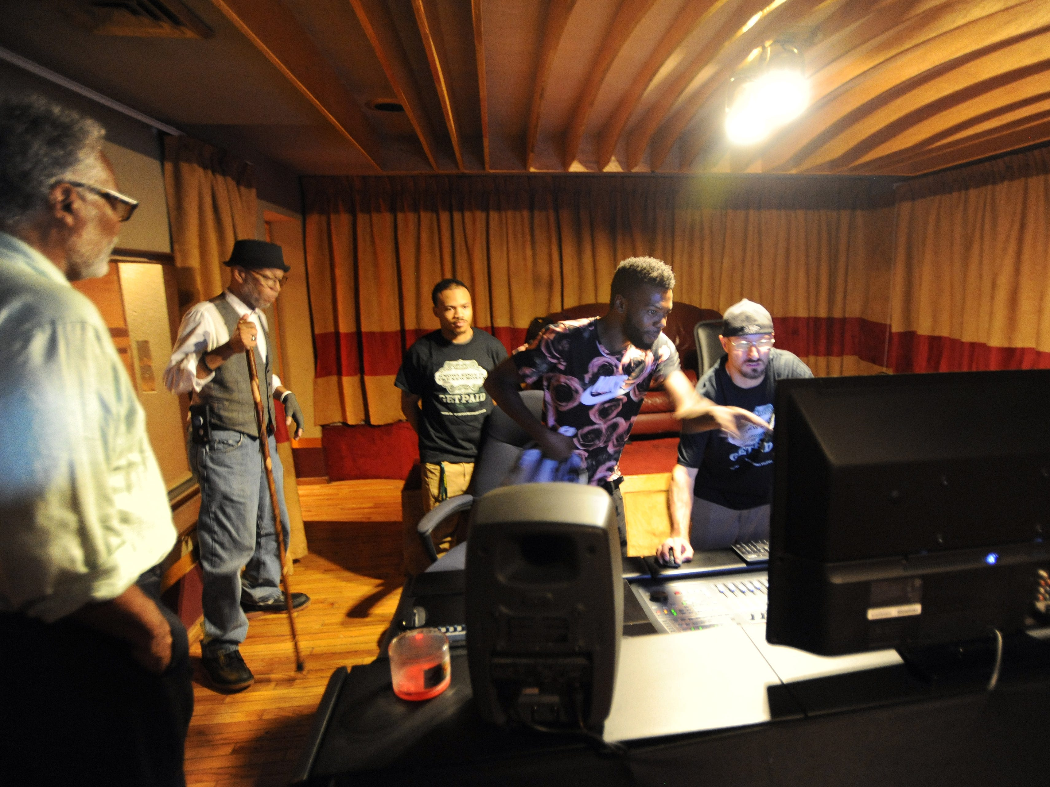 Visitors look over part of Studio B, inside United Sound Systems Recording Studios.