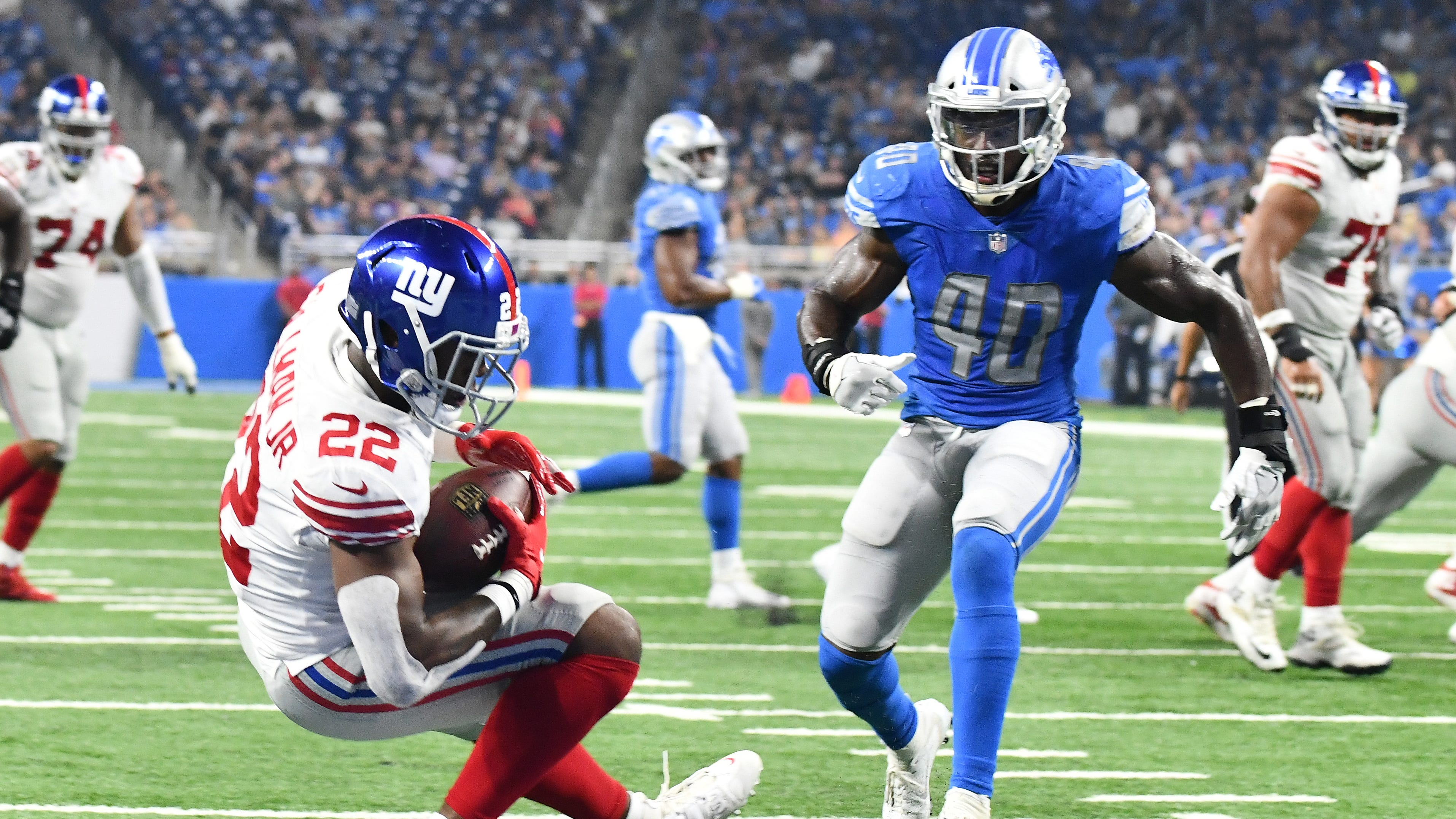 Wayne Gallman Jr. scores one of the four touchdowns the Giants put up on the Lions in Friday's preseason game.