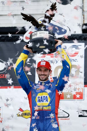 Alexander Rossi poses in Victory Lane after winning Sunday's IndyCar race at Pocono Raceway.