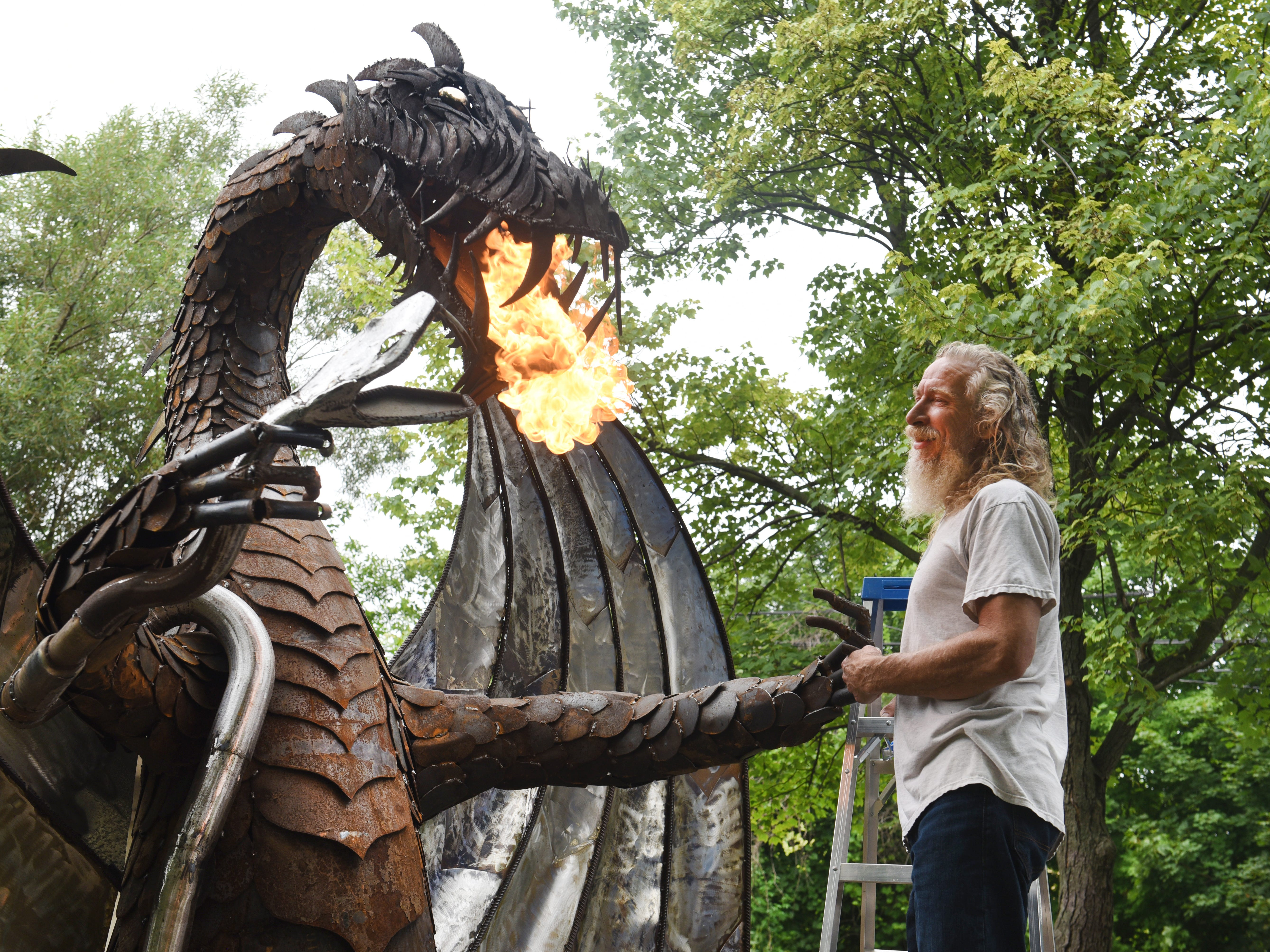 Keith Coleman stands with his 12-foot fire breathing dragon on Thursday, August 16, 2018.