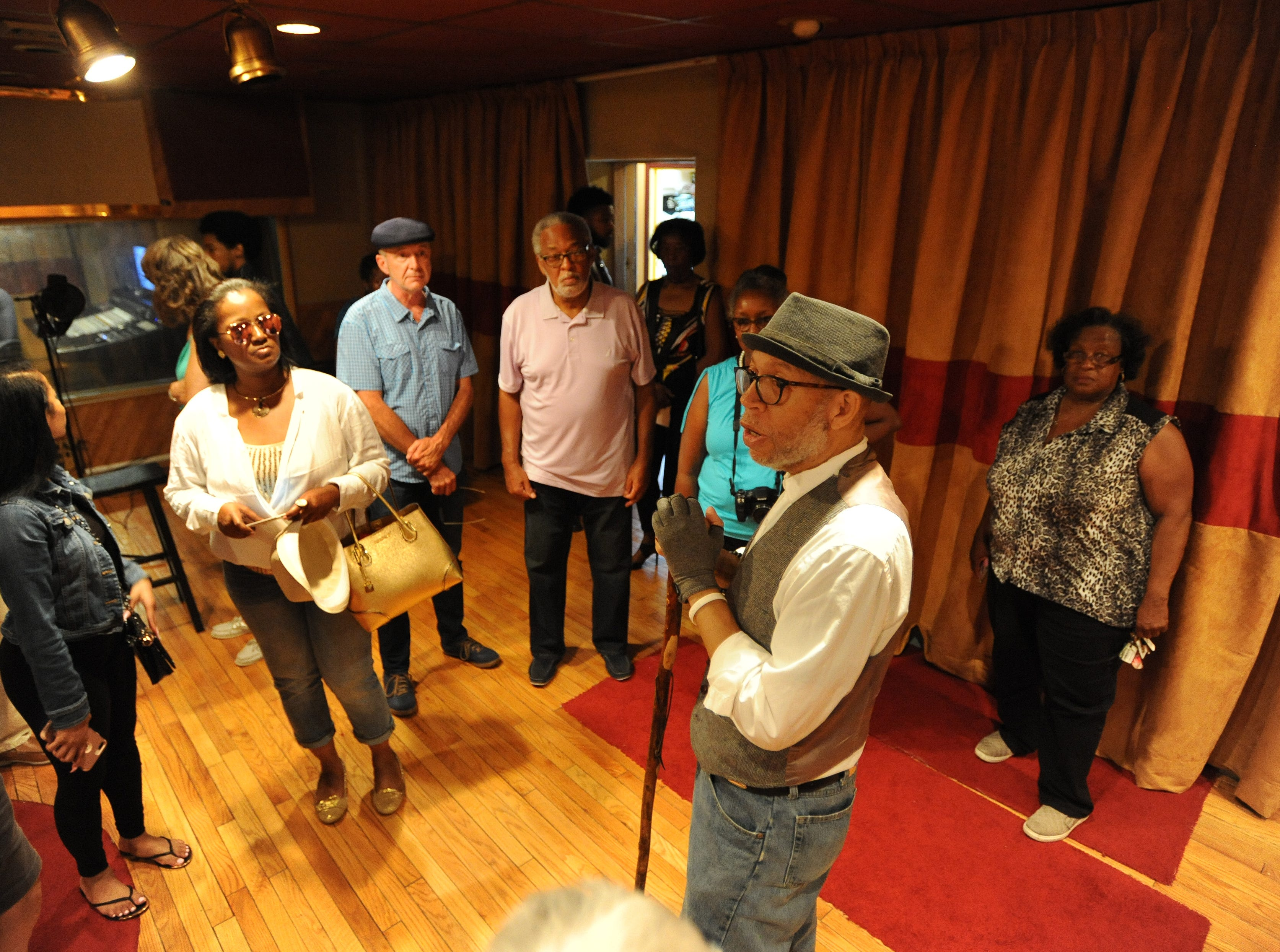 Tour guide and historian Alex Alexander, foreground, talks about the history  of United Sound Systems Recording Studios.