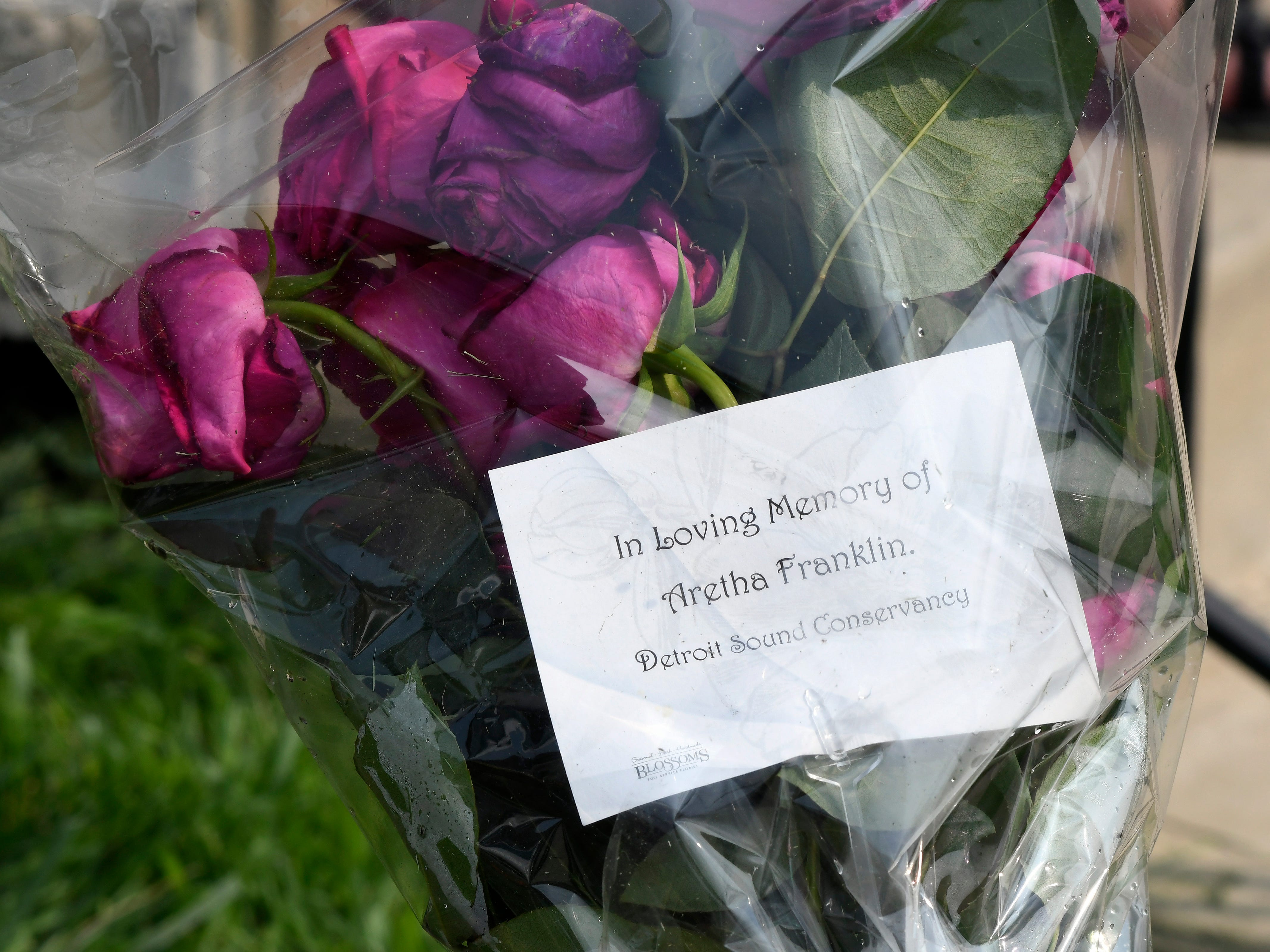 Flowers are placed outside United Sound Systems Recording Studios to honor Aretha Franklin, who recorded much of her music there.