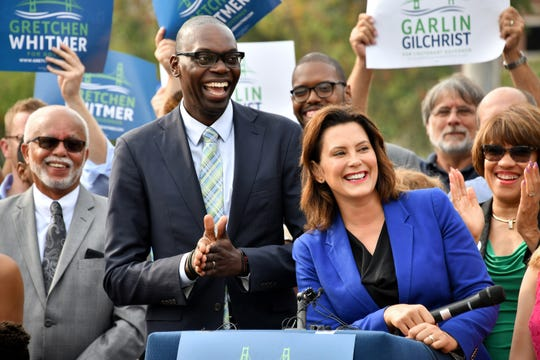 Garlin Gilchrist II and Gretchen Whitmer are all smiles at Monday's announcement in downtown Lansing.