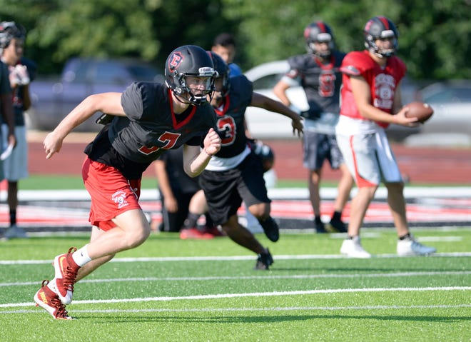 Livonia Churchill went 8-3 last season and returns most of its offense, including receiver Avery Grenier.