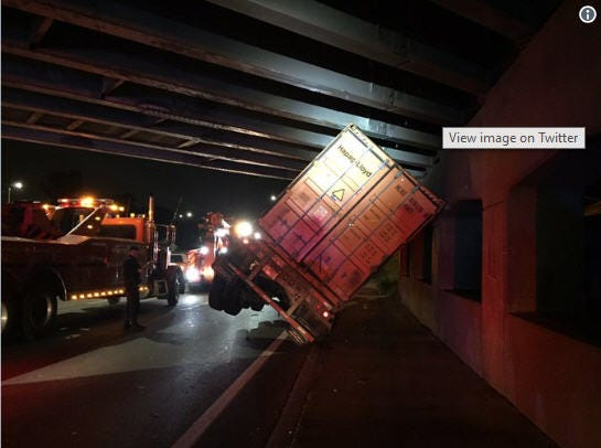 A semi tipped on westbound Interstate 94 blocked lanes of traffic on August 20, 2018.