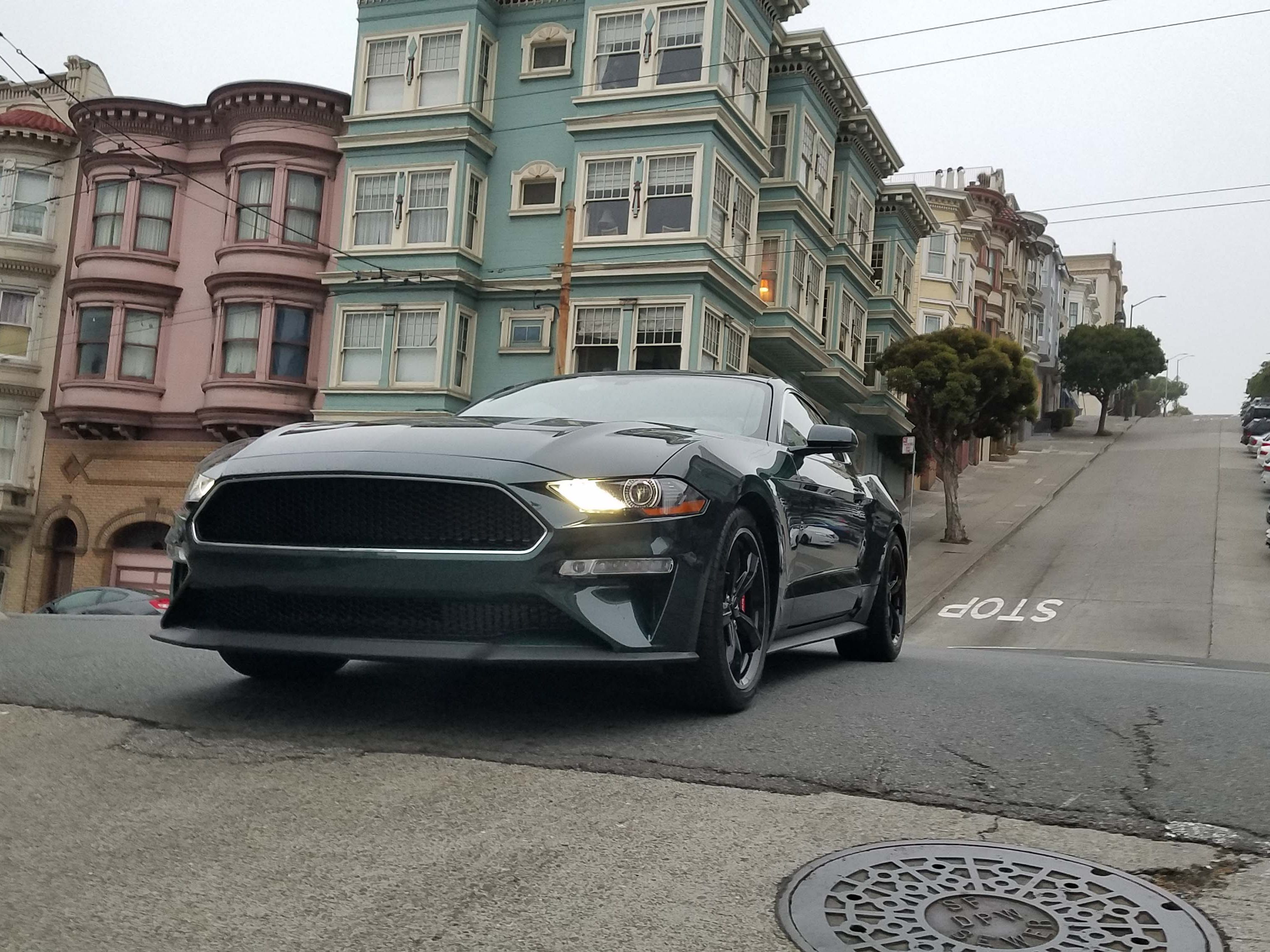 Not airborne. A 2019 Ford Mustang Bullitt plies the same Russian Hill streets — but at lower speed — as the original, 1968 movie car.