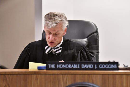 Judge David J. Goggins reads his findings during the preliminary examination hearing at 67th District Court in Flint on Aug. 20, 2018.