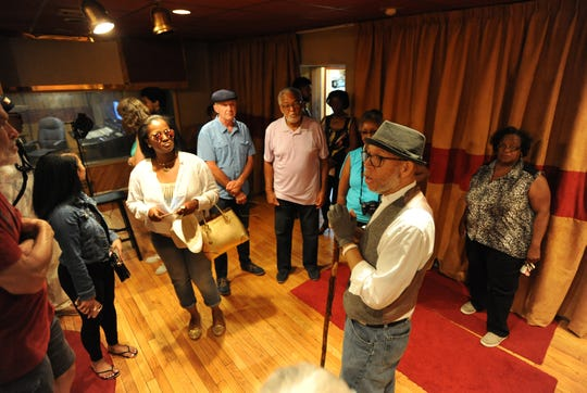 Tour guide and historian Alex Alexander, foreground, talks about the history  of United Sound Systems Recording Studios, Sunday, Aug. 19, 2018 in Detroit.