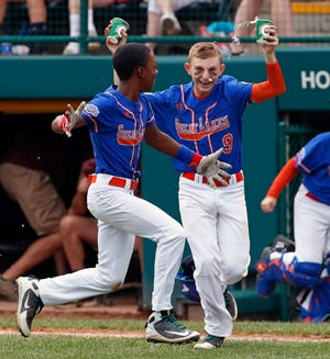 Grosse Pointe's Reggie Sharpe, left, celebrates with Cameron Schafer after Sharpe drove in the winning run on Monday.