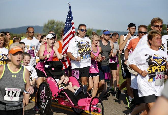 Runners take part in the Time to Sperr race in memory of slain state Trooper Andrew J. Sperr.