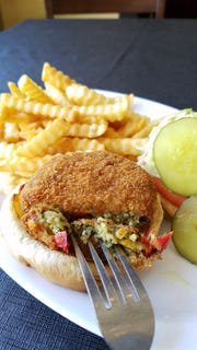 The Indian paneer burger at The Rooftop Food and Drinks could double as an appetizer. It's cheesy, moist, spicy, flavorful and crunchy-fried. On a bun, it makes a delightful sandwich.