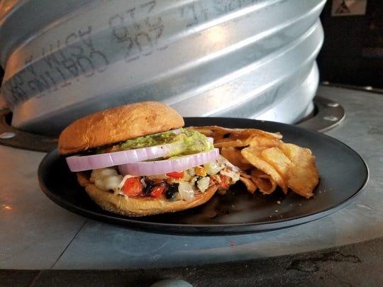 The Southwest-inspired veggie burger at  Bokeh Lounge contains corn, peppers and black beans and is topped with guacamole.
