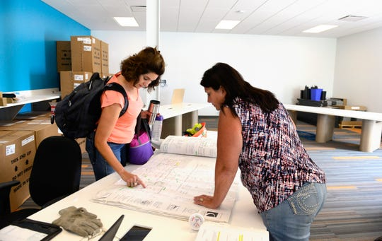 Rudolph Libbe project manager Annette Stuller, left, and WSOS administrative and IT director Kerry Adkins look at the blueprint for the Northwest Ohio Technology Learning Center that will be located in WSOS' new headquarters.