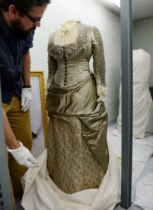 """Kevin Moore, associate curator at the Rutherford B. Hayes Presidential Library and Museums, shows Lucy Webb Hayes' """"Ashes of Roses"""" gown, which she wore to the wedding of her son Birchard Hayes in 1886."""