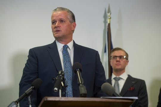 Weld County District Attorney Michael Rourke speaks to reporters and photographers during a press conference giving updates on charges filed against Chris Watts at the Centennial Center in Greeley on Monday, August 20, 2018. Watts is charged with five counts of first-degree murder in connection with the death of his pregnant wife, Shanann and their daughters, Bella and Celeste.