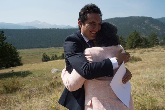 Lola Ayala embraces her nephew, Axel, after he became a United States citizen during a Naturalization Ceremony in Rocky Mountain National Park on Monday, August 20, 2018. 70 people from 35 countries took the Oath of Allegiance and became citizens during the ceremony.