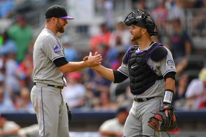 Relief pitcher  Wade Davis , left, and catcher Chris Iannetta congratulate one another Sunday after the Colorado Rockies completed a four-game sweep of the Braves in Atlanta. The Rockies, winners of eight of their past nine games, return home Tuesday night to begin a six-game homestand with a 6:40 p.m. game at Coors Field in Denver against the San Diego Padres.