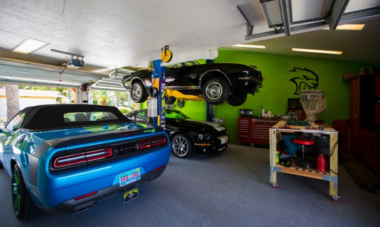 "This is real estate agent Kevin Cloutier's three-car garage where he established his ""man cave."" Cloutier is also working on a project in Cape Coral, to develop a high-end man cave community geared toward Cape Coral residents who have run out of room for the toys at their house."