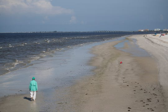 A clean beach can be seen from the Fort Myers Beach Pier on Wednesday 8/14/2018. Despite reports of clean beaches in Southwest Florida some areas are seeing large changes in red tide counts throughout the area.
