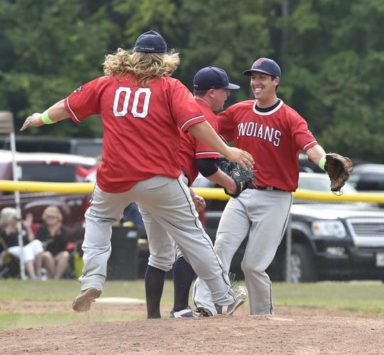 Egg Harbor first baseman Casey Giesseman, left, and shortstop Eric Dejardin, right, celebrate their 2-1 victory over Sister Bay with pitcher Al Byrne during the regular-season championship tiebreaker at Egg Harbor on Sunday. Byrne pitched all nine innings. To see more photos: doorcountyadvocate.com.
