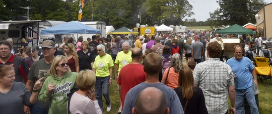 Some of the estimated 4,000 people who attended last year's Death's Door B-B-Q on Washington Island.