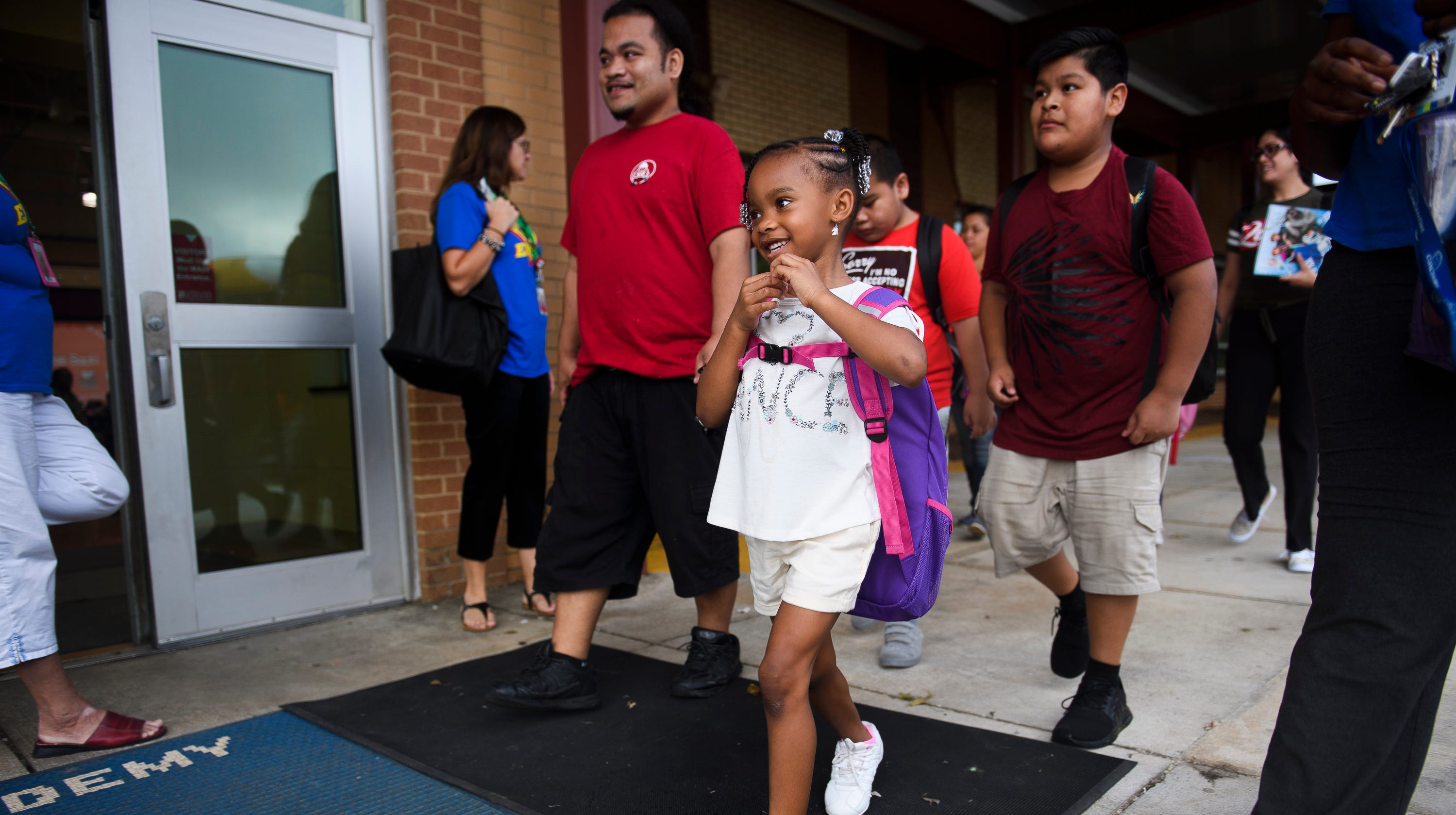 London Thompson walks to her first day of school at East North Street Academy on Monday, Aug. 20, 2018.