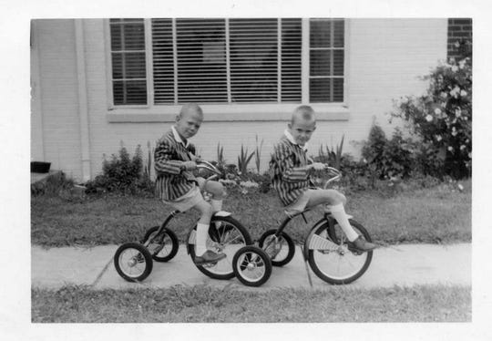 Future columnist Ron Barnett, left, and his twin brother Paul, play outside their family's apartment in what is now Clemson's Douthit Hills student complex.