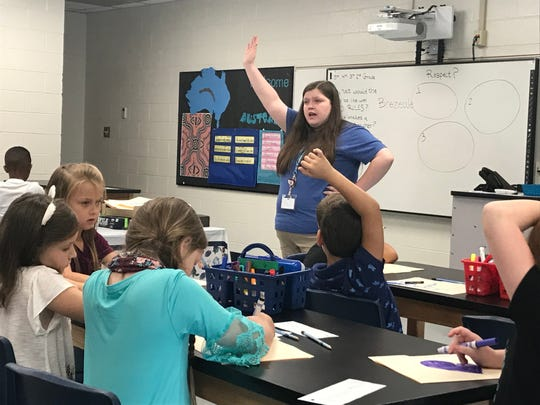 Brianna Reeves elicits a response from her art class in her first day as a teacher at Hagood Elementary School in Pickens