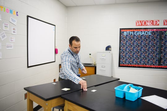 Jeff Haigler prepares for his next class during his first day as a science teacher at Sevier Middle School on Monday, Aug. 20, 2018.