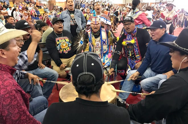 The Blackfoot Confederacy drum group performs at Crow Fair. The group includes members from Montana and Canada.