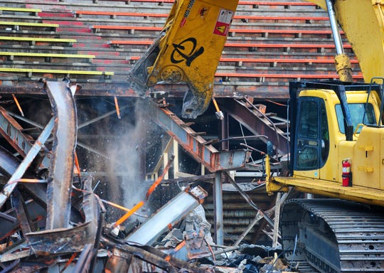 A Steel Etc. processing shear carefully removes the steel framework of the old grandstands at Montana ExpoPark, Monday.  The $2.8 million grandstands project began Monday morning with the demolition of the old 2,000 seat structure, which scheduled to be replaced by spring of 2019.
