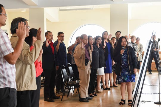Democratic Party of Guam Secretary Jennifer Louise Dulla leads candidates in a unity pledge at the Latte of Freedom in Adelup in this Aug. 20, 2018, file photo.