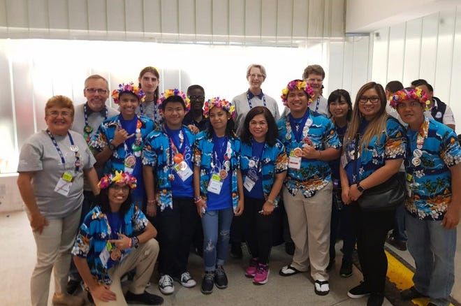 Guam's robotics team representatives for the 2018 FIRST Global Challenge with their supporters. High school students Adrian Tambora, Danny Morta, Bazyll Garcia, Carissa Lazaga, and Avinash Dhanraj, travelled to Mexico City for the competition where they won a third place Clara Barton Award for Helping Hands.