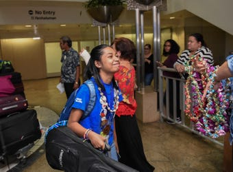 Guam's robotics team are given a welcome celebration at the Antonio B. Won Pat International Airport on Aug. 20, 2018.