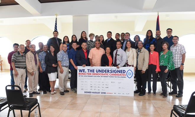 Democratic candidates of the 2018 Guam Primary Election signed a unity pledge at the Latte of Freedom in Adelup, Aug. 20, 2018.
