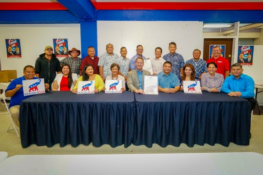 Lt. Gov. Ray Tenorio and other Republican candidates during Friday's signing of a pledge of unity.