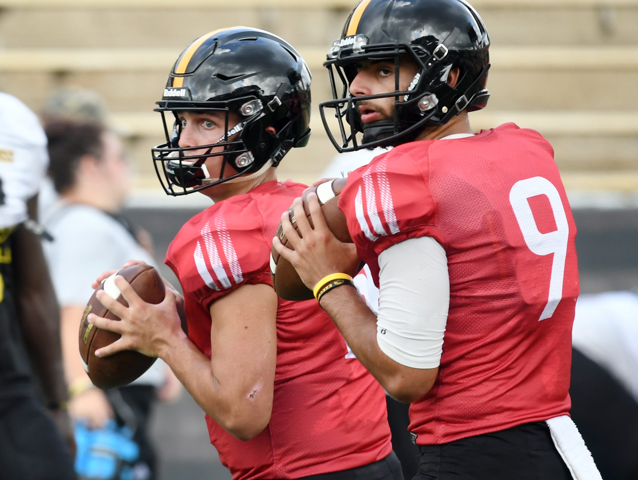 Southern Miss quarterback Jack Abraham, left, and Marcelo Rodriguez, right, look for their receivers during the teams last week of fall camp on Monday, August 20, 2018.