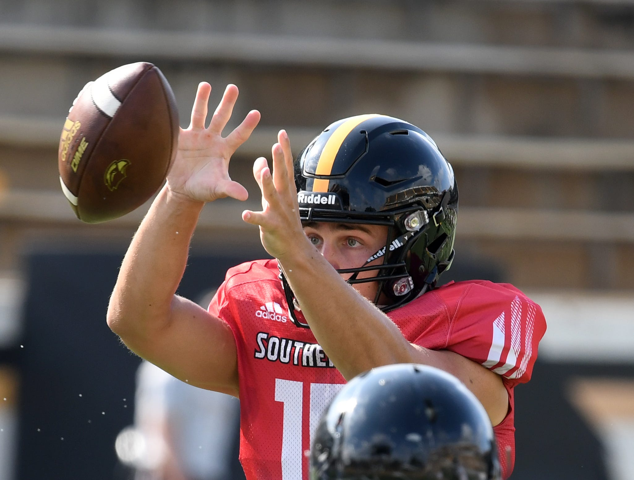 Southern Miss quarterback Jack Abraham catches the snapped ball during the teams last week of fall camp on Monday, August 20, 2018.