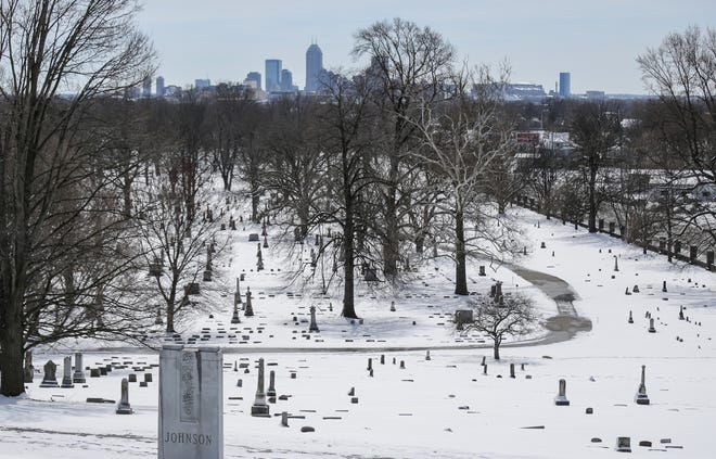 Snow blankets the grounds of Crown Hill Cemetery and Funeral Home in Indianapolis on March 25, 2017.