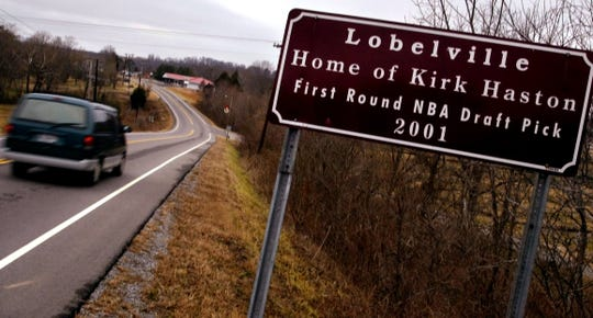 Kirk Haston's hometown of Lobelville honors him with a sign on Highway 13 as motorists enter the city limits.