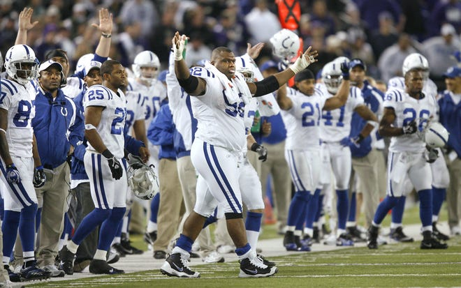 Indianapolis Colts defensive tackle Anthony McFarland and the rest of the team celebrate the last fieldgoal by Adam Vinatieri to seal the game with a score of 15-6 in the AFC Playoff game at M&T Bank Stadium in Baltimore, January 13, 2007.