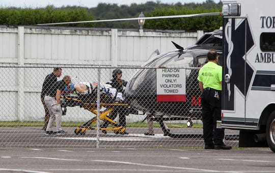 Verizon IndyCar Series driver Robert Wickens is loaded onto a helicopter to be taken to a Pennsylvania hospital after an accident during the ABC Supply 500 at Pocono Raceway.  Matthew O'Haren-USA TODAY Sports