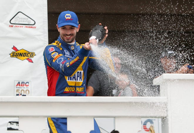 Verizon IndyCar Series driver Alexander Rossi celebrates in victory lane after winning the ABC Supply 500 at Pocono Raceway. Mandatory Credit: Matthew O'Haren-USA TODAY Sports